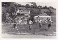Cwmdu schoolchildren playing with hula hoops.