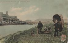 Coracle fishermen and children on the Towy