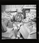Quarryman splitting a large piece of slate