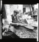 Quarryman dressing a roofing slate
