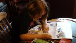 Kelsey filling in her reading form ready for...