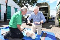 First Minister Carwyn Jones learning CPR with...