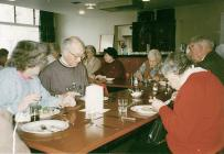 Senior friends having lunch in the coffee bar...