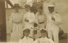 Group of men and women on an unidentified ship ...