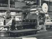 Factory worker at production line, Rheola Works...