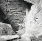 Looking down into deep chamber, Aberllefenni...