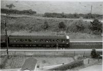 Diesel BR train passing NEWTOWN sign