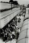 Passengers disembark at Newtown Railway Station