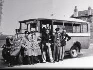 A bus with drivers and conductors.