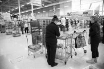 Supermarket staff with hand sanitiser, Tesco,...