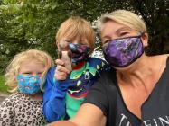 Aileen and her grandchildren wearing face masks...