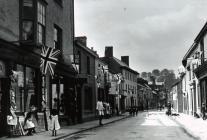 Bridge Street, Usk with Union Jacks May 1900
