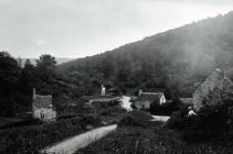 Cottages and woman at Llangybi, c1900
