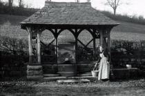 Well with woman collecting water, Usk area c.1900