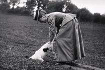 Llangibby House party, woman with dog, 1902