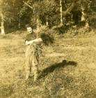Land Army woman with hay, Nanteos Mansion, 1943