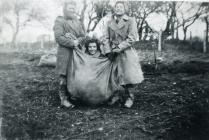 Land Army women in a sack race