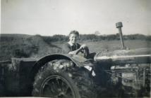 Land Army Woman on a tractor