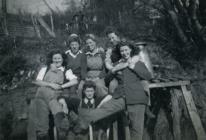 Land Army women by a milk churn
