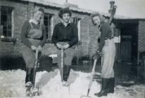 Land Army women digging snow, Bow Street