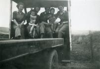 A group of Land Army women with children
