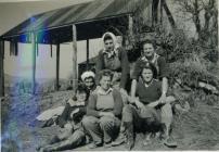 Land Army women outside a barn