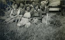 A group of Land Army women relaxing