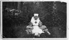 Red Cross Nurse with Children