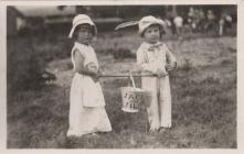 Two children at Rhayader Carnival, late 1930s