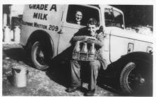 Annie Pugh and Bob Johnson delivering milk in...